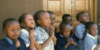 Children at prayer in Africa